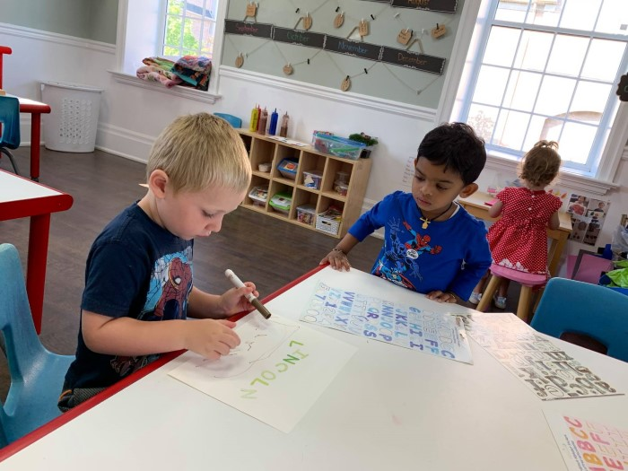 Two little boys are learning letters in EarlyON Years Centre