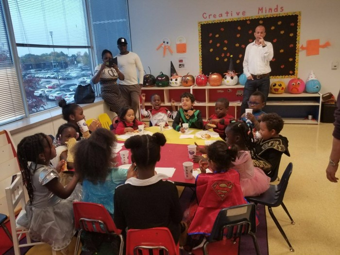 Kids are sitting at the table during the event in EarlyON Years Centre