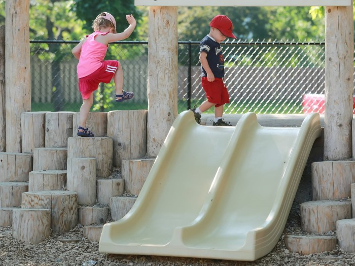 Kids are climbling wooden steps in EarlyON Years Centre
